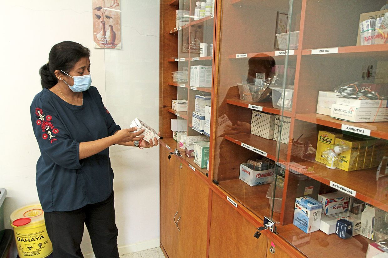 Dr Vanitha preparing medications which the hospice provides free for its patients. Photo: The Star/Yap Chee Hong