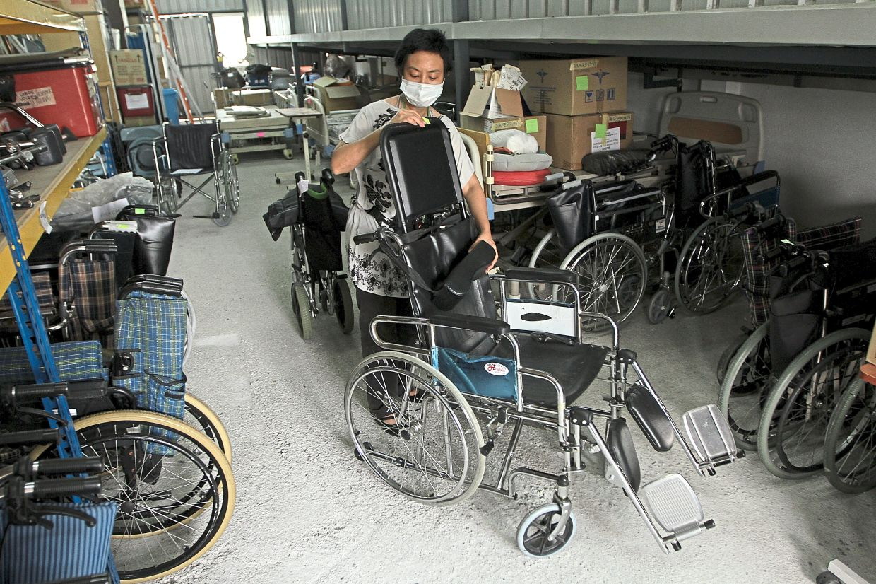 Kasih Hospice loans out expensive equipment such as wheelchairs, electric hospital beds and mattresses to its patients free-of-charge. Photo: The Star/Yap Chee Hong