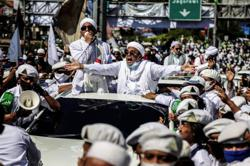 Indonesian cleric apologises for rallies amid questions over his Covid-19 test