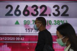 Asian markets fluctuate after rally, eyes on US stimulus talks