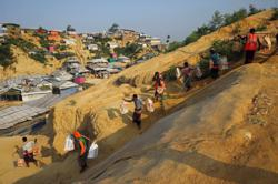 Rohingya coerced into going to remote island, refugees and aid workers say