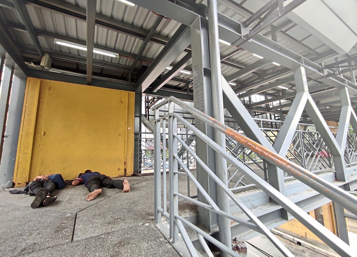 Vagrants, drunks and drug addicts are the only ones using the bridge connecting the school at Jalan Sultan Abdul Samad.