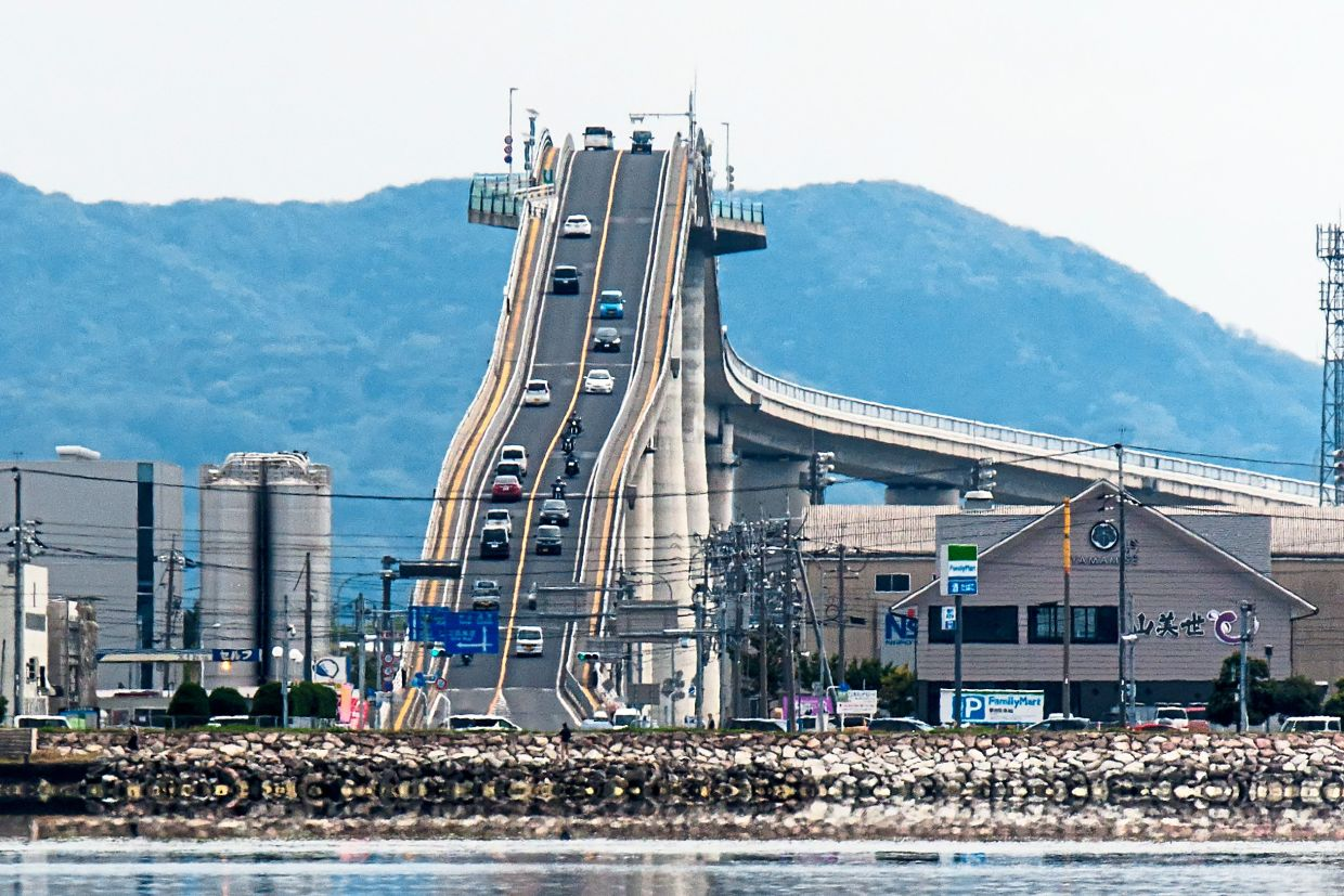 This incredibly steep bridge in Japan is more like a rollercoaster, and it connects the cities of Matsue and Sakaiminato, above Lake Nakaumi. You definitely won't find any pothole on the road on this bridge. — Photos: Handout