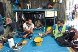 Penang begins screening foreign workers