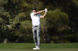 Chile's Niemann grabs share of clubhouse lead in Mexico