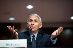 Fauci apologises for casting doubt over UK's approval of Pfizer vaccine