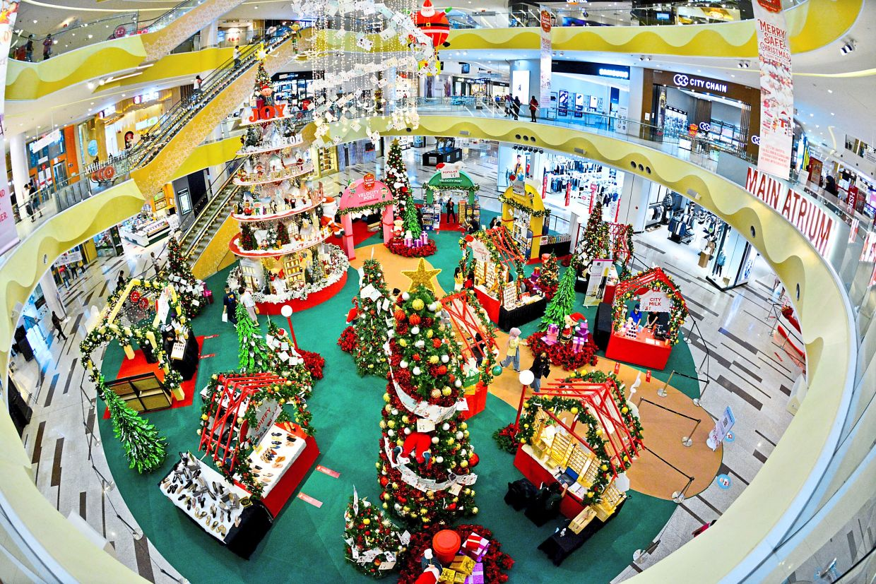 Sunway Velocity's main atrium has a 10m-tall Christmas tree beside push cart stalls selling toys, candies and Christmas  ornaments.