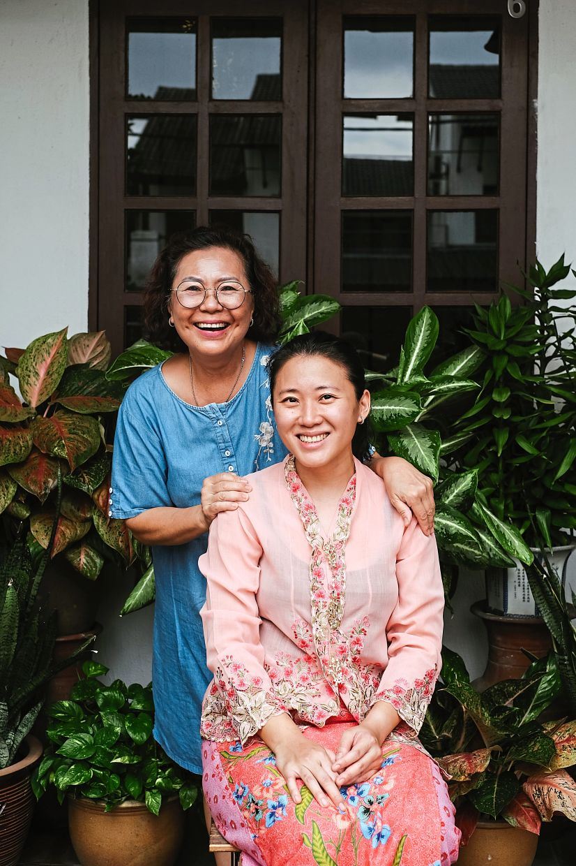 Looking beyond: Lim (right), seen here with her mother, hopes to bring the Peranakan food and culture to a wider audience.