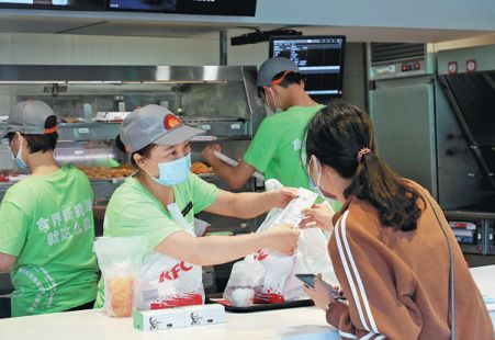 A customer orders artificial meat at a restaurant in Guangzhou, Guangdong province, in April. - Xinhua