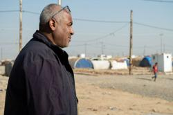 Islamic State shadow follows families as Iraq closes camps