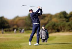 Donaldson storms into share of lead with Bezuidenhout