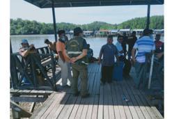 Wildlife rangers working to catch crocodiles roaming Sabah