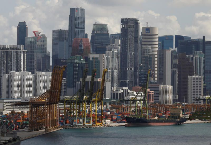 A ship docks at Keppel terminal in Singapore. - Reuters