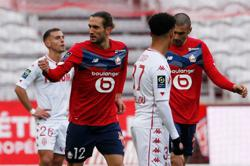 Lille beat Monaco to cut PSG's lead to two points