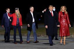 Georgia Republican Senator Loeffler dodges questions on Trump during debate with challenger Warnock