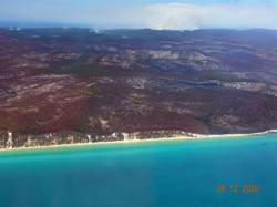 Firefighters slow bushfire threatening township in Australia's Fraser Island