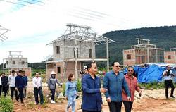 Lao hydropower plant developer builds homes for flood victims