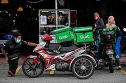 Disabled delivery rider on 'frontline' of Malaysian virus war