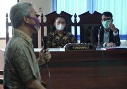 In conservative Indonesia, a gay ex-policeman takes his battle to court