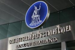 Thai baht gives up gains as talk of c.bank intervention swirls