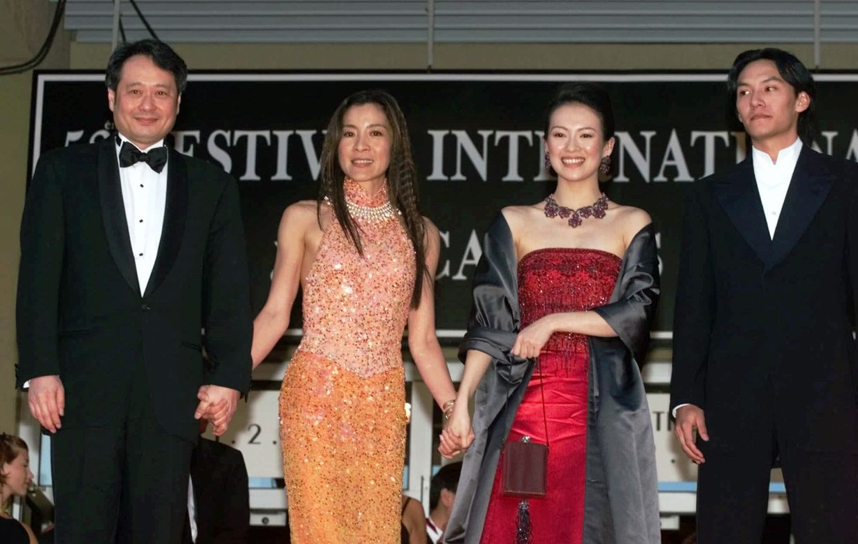 (From left) Director Ang Lee poses on the steps of the Festival Palace with actors, Michelle Yeoh, Zhang Ziyi, and Chen Chang after the screening of their film 'Crouching Tiger, Hidden Dragon, at the 53rd International Film Festival in Cannes, France, on May 18, 2000. Photo: AP