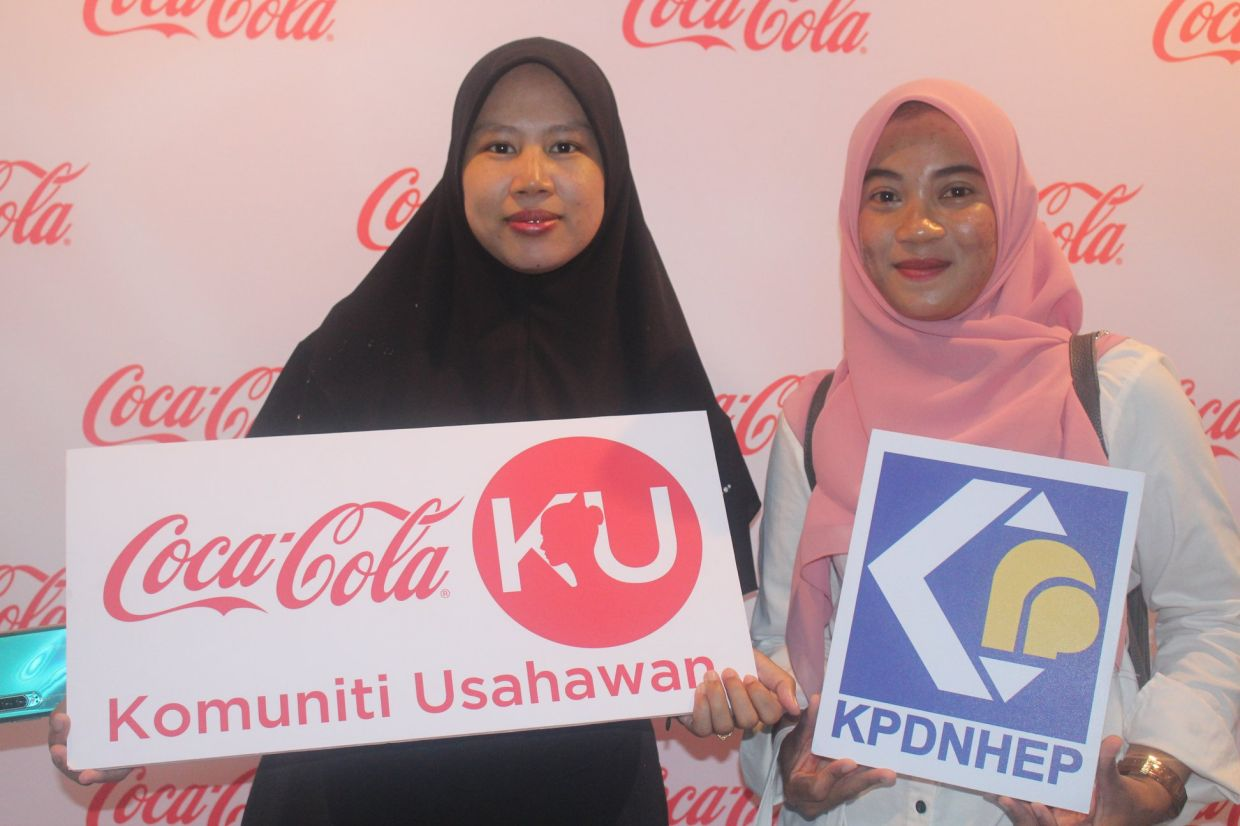 Coca-Cola KU participant, Zubaidah A. Aziz (left) with another participant. Since its inception in 2017, Coca-Cola KU has supported almost 16,000 women participants in Malaysia.