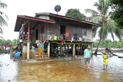 Stagnant floodwaters a perennial problem for four families in Marang