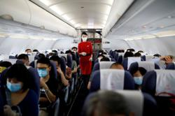 China tells cabin crew to wear diapers on risky Covid-19 flights