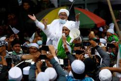 Jakarta police name FPI leader Rizieq as suspect in mass event probe