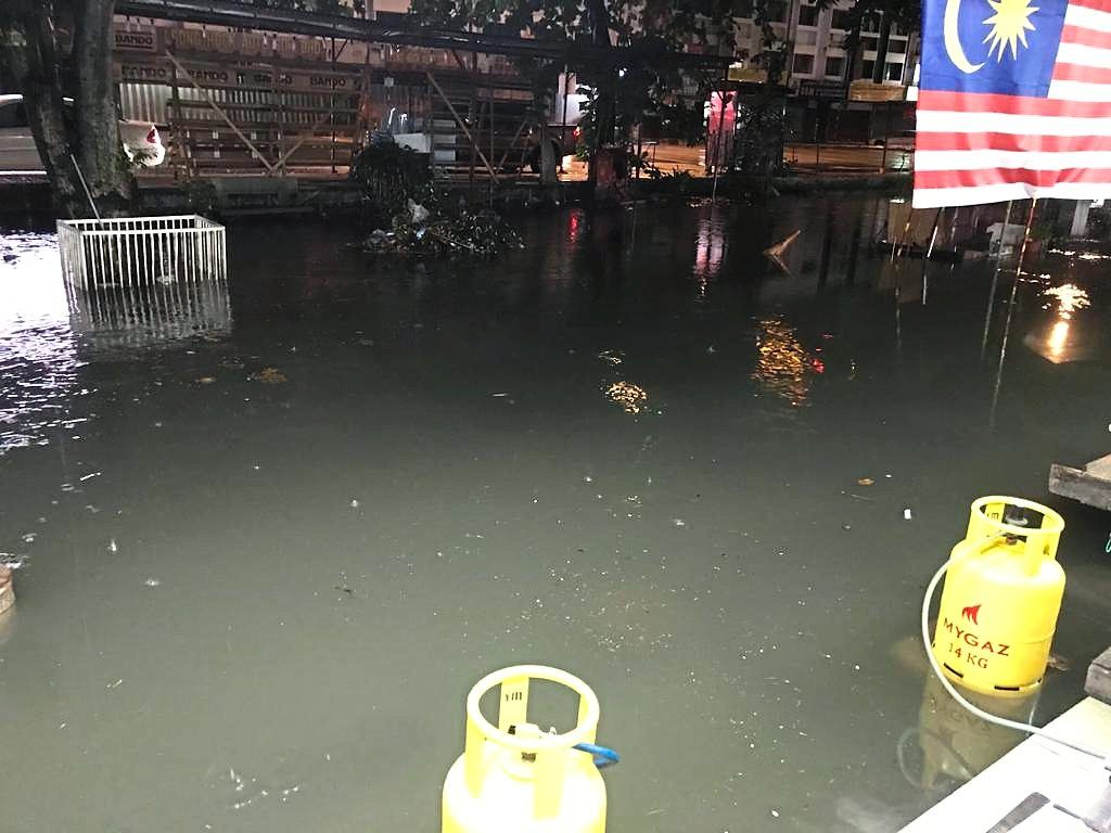 Floods overwhelm the food court in Jalan Tiong whenever it pours. — Photos: LOW BOON TAT/ The Star