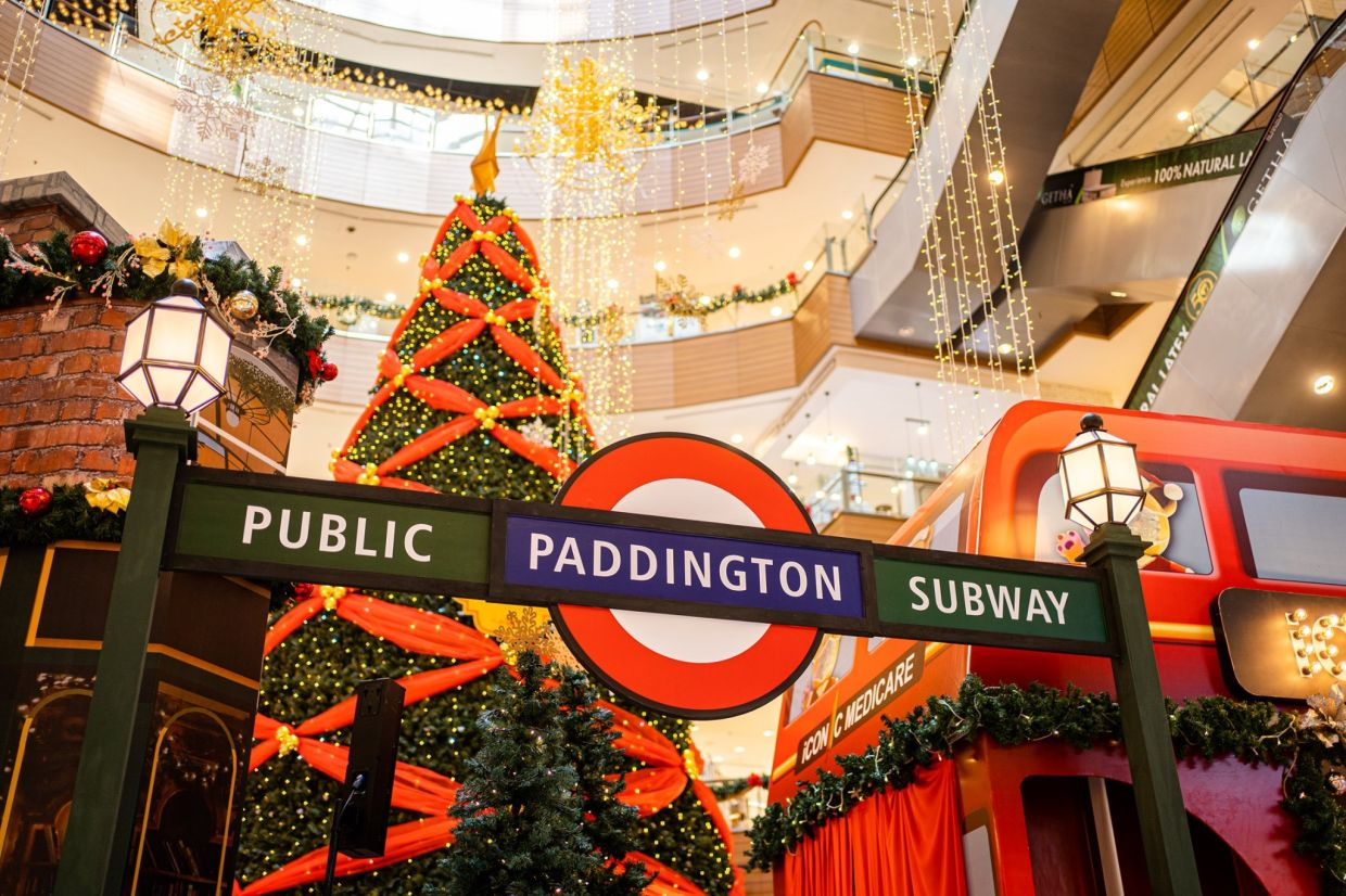 London's iconic double decker buses and underground station signages are recreated for the festive display.