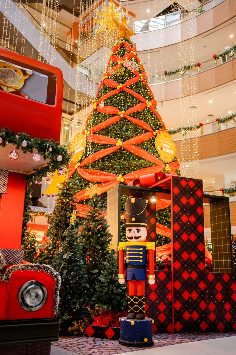 The centerpiece 40ft tall Christmas tree looks splendid with red ribbons and gold ornaments.