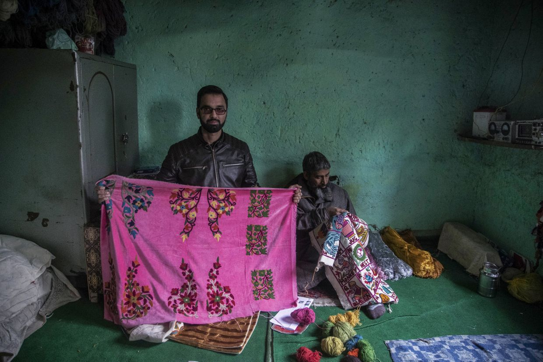 Kashmiri entrepreneur Basharat Ashraf, left, displays a piece of work, as artisan Imtayaz Ahmad works inside their workshop in Srinagar, Indian controlled Kashmir. Photo: AP