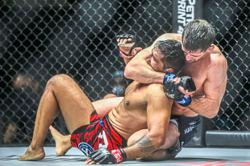 Agilan goes down to McGuire in Singapore