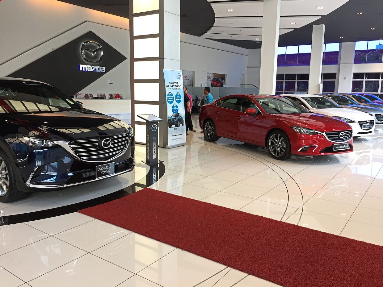 Positive outlook: Mazda showroom in Shah Alam. The better Q3 earnings expected for BAuto are based on an improved performance by its unit Mazda Malaysia Sdn Bhd and better sentiment in the export markets.