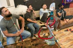 Signature wooden waterpipes keep bubbling in Iraqi shrine city