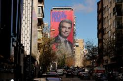 Soccer-Barca candidate Laporta goads Real Madrid with cheeky campaign poster