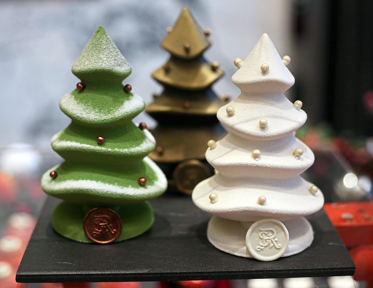 Chocolate Christmas Trees filled with homemade pralines and candies.