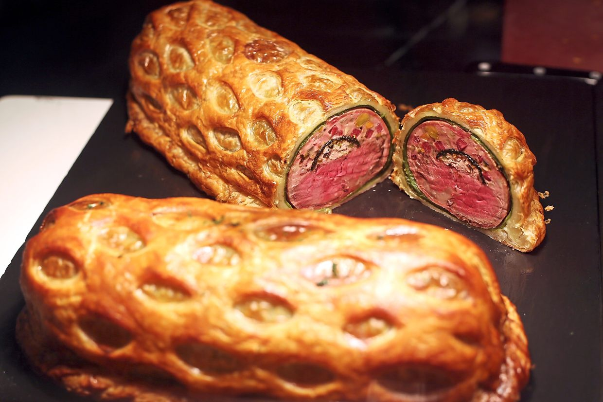 An enticing and perfectly baked beef Wellington is presented on the buffet at The Brasserie.