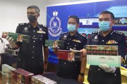 Melaka cops raid two sundry shops selling illicit cigarettes to children