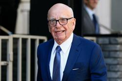 Murdoch receives COVID-19 vaccine as Fox News host casts suspicion on campaign
