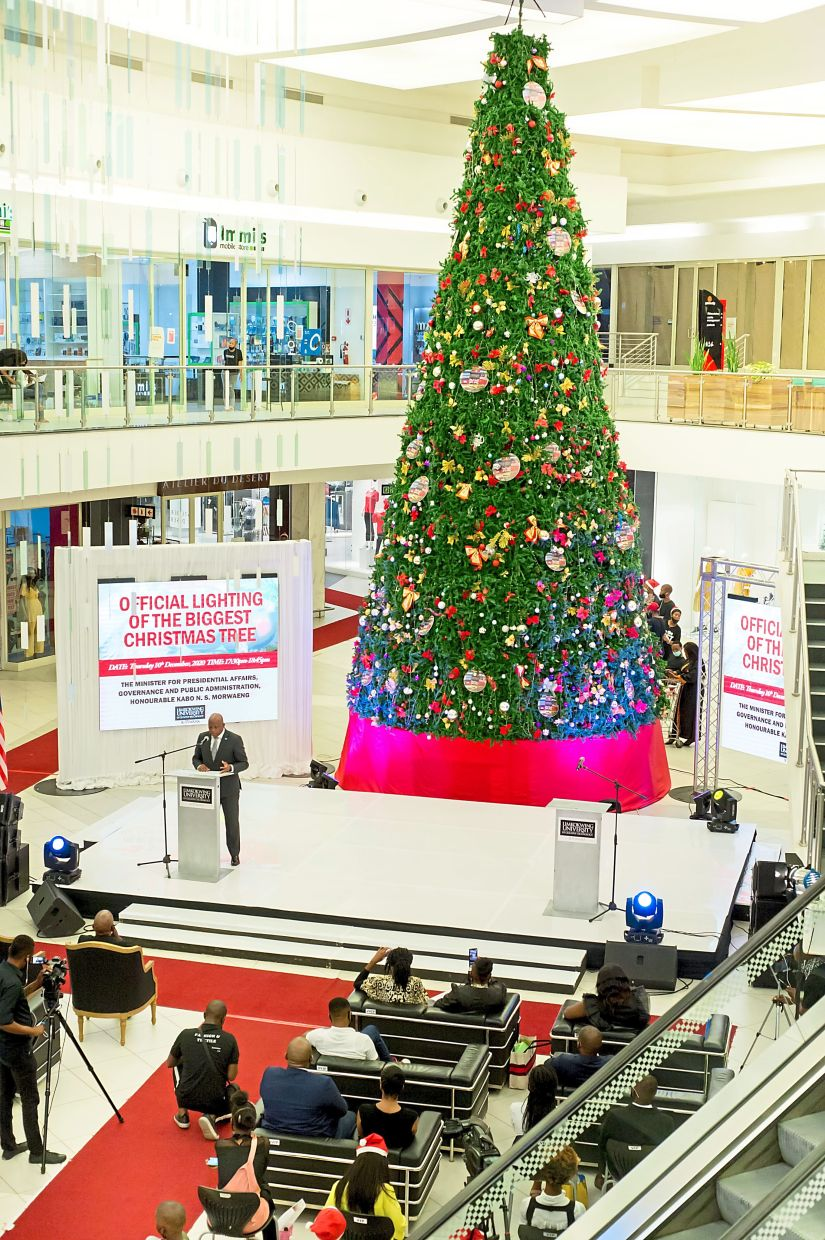 Light it up: Morwaeng (top left) delivering his speech at the official lighting of the biggest Christmas tree.