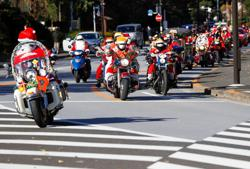 Santa Claus bikers parade in Tokyo against child abuse