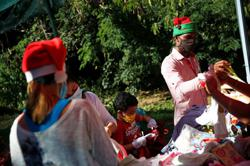 In pandemic and recession, Santa Claus gifts bread and clothes to poor Venezuelan kids