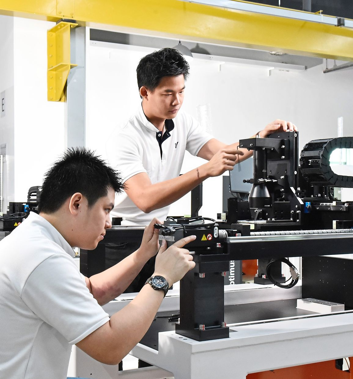 Manufacturing engineers assemble and conduct testing of the automated optical inspection system.