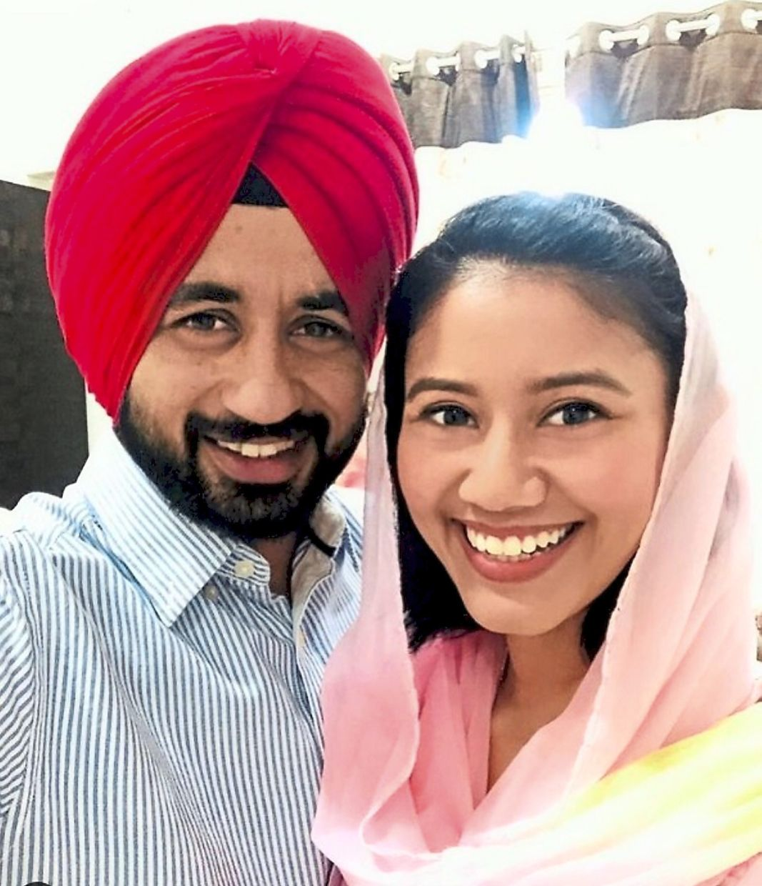 Happy couple: An Instagram photo from Illi's account showing her with Manpreet.