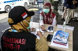 Indonesia to get Covid-19 vaccine data from Brazil after its clinical trial is stuck