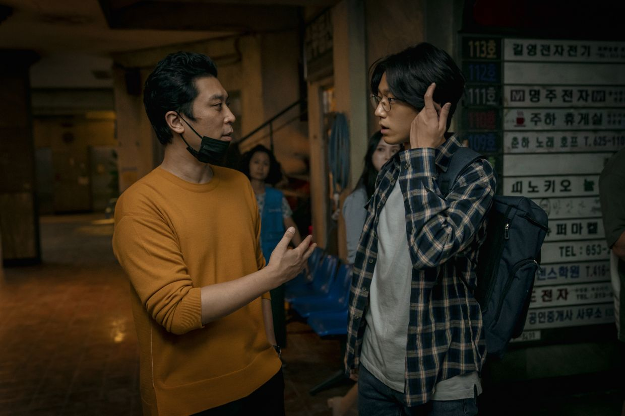 Director Lee Eung-bok with actor Lee Do-hyun on the set of 'Sweet Home'.