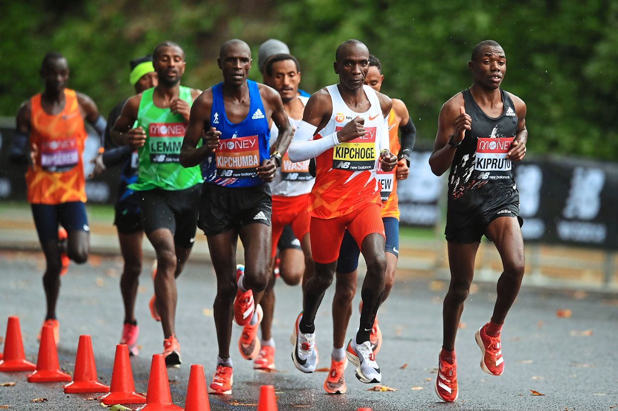 Long distance runners, such the ones seen here during the 2020 London Marathon in October, tend to have smaller calf muscles. — AFP