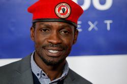Uganda's Bobi Wine says bodyguard killed by police who deny charge; three reporters hurt
